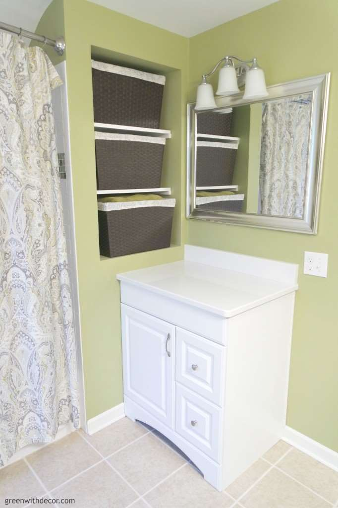 A great list of the best neutral paint colors for the whole house. This bathroom, is Ryegrass, looks great with the white vanity and white trim!