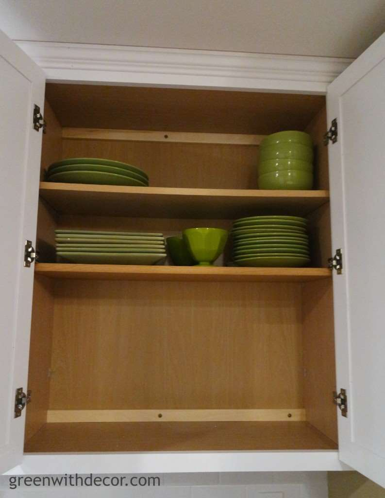 Add extra storage in the kitchen cabinets with this easy trick! | Green With Decor