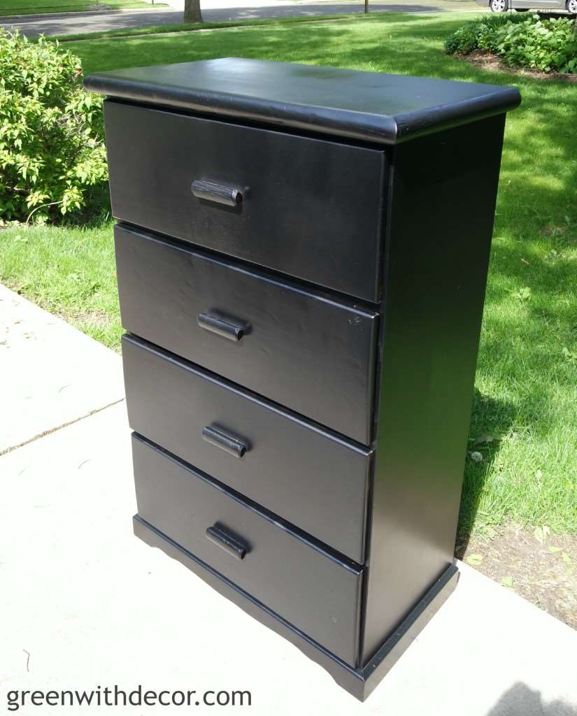 How to paint a dresser – a black painted dresser sitting in the driveway