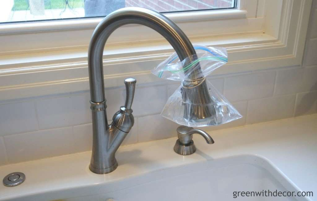 This is such an easy way to clean the bottom of the kitchen faucet! | Green With Decor