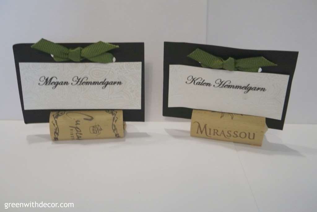 Alt text: Green With Decor – Save money by making your own wedding place cards. Follow these easy steps to make place card holders from wine corks, card stock and ribbon.