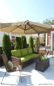 This backyard looks awesome! I love the big couch and umbrella! How relaxing! | Green With Decor – 5 top priorities when planning a backyard oasis