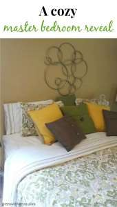 Oh my gosh, what a cute master bedroom! I love all the throw pillows!| Green With Decor