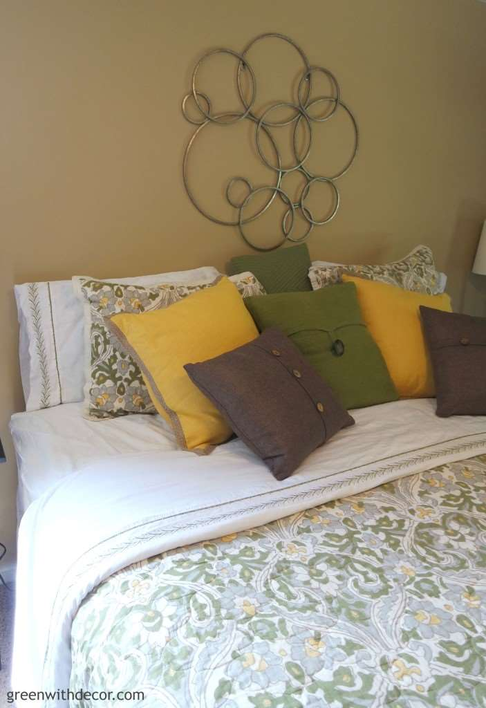Love the colors in this bedroom! And so many throw pillows! From Green With Decor