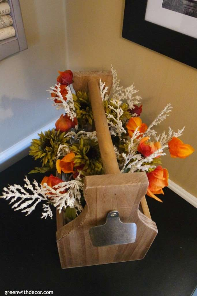 What a fun use for a wooden drink caddy from Green With Decor! Stick in some flowers, and it's a fall decoration!