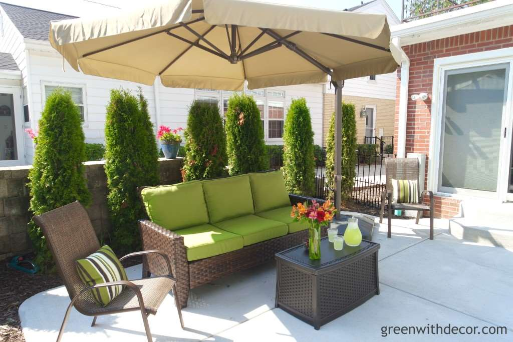 A relaxing patio oasis! Love that couch with the green cushions! From Green With Decor