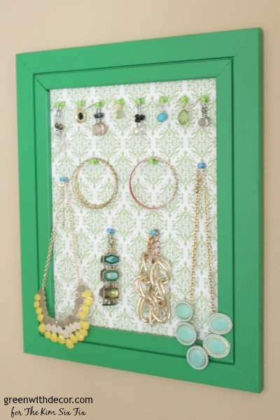 A list of the 10 best pieces to buy at the thrift store - frame turned jewelry display