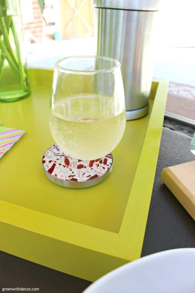 Wine and cheese on the patio! And those cool recycled glass colorful kitchen gadgets! I wish I had this colorful patio. What a fun place to relax!