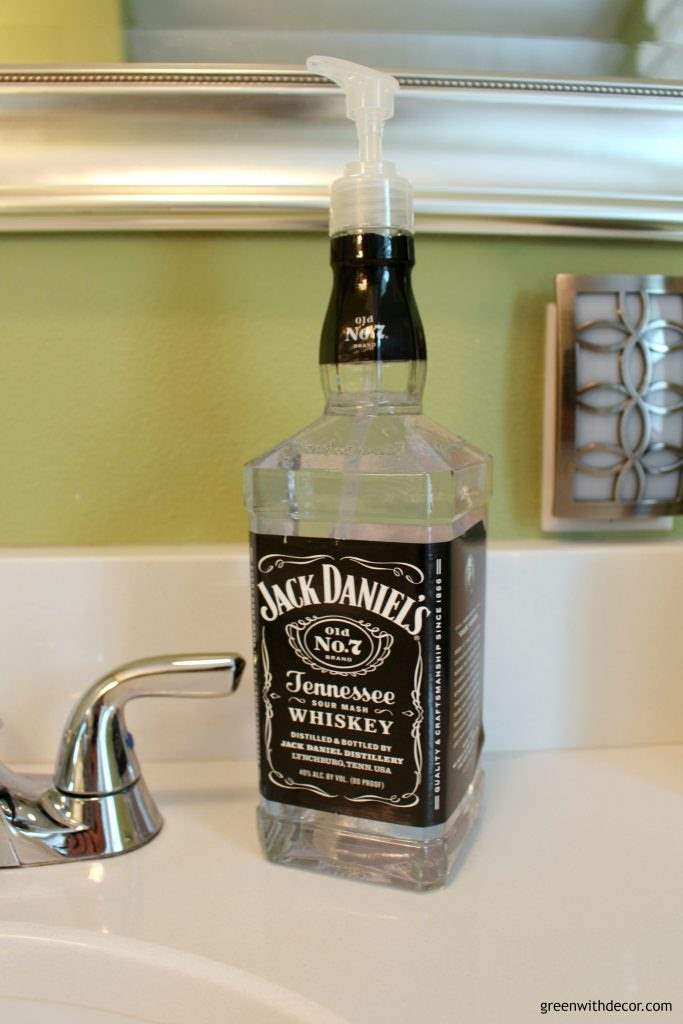 A DIY Jack Daniels soap dispenser on a white counter