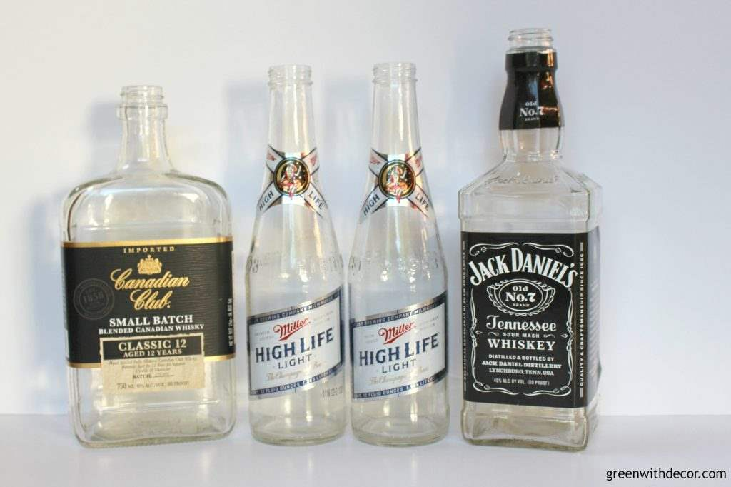 Empty beer and liquor bottles to use for a DIY soap dispenser