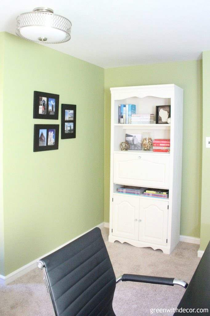 Love this home office makeover! She organized the craft closet, hemmed curtains and painted a huge bookshelf. Love all of the projects and none of it was expensive!