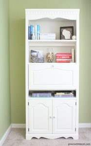 Wondering how to paint a bookshelf: spray it or paint it by hand? She gives a great tutorial for painting a bookshelf with clay paint. The white paint on this bookshelf brightens up the entire room it's in!