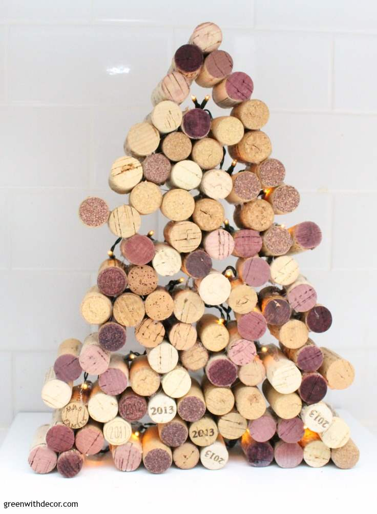 How to make a cork Christmas tree. Such a fun cork DIY project, and love that this little tree lights up! What a fun Christmas decoration or gift idea.