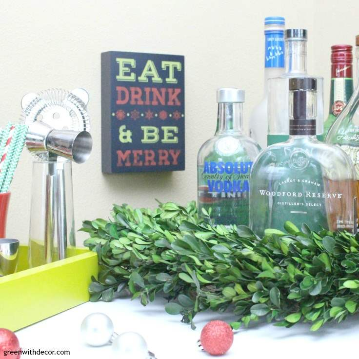 tips-setting-up-holiday-cocktail-bar-bottles-wreath-ornaments-tray