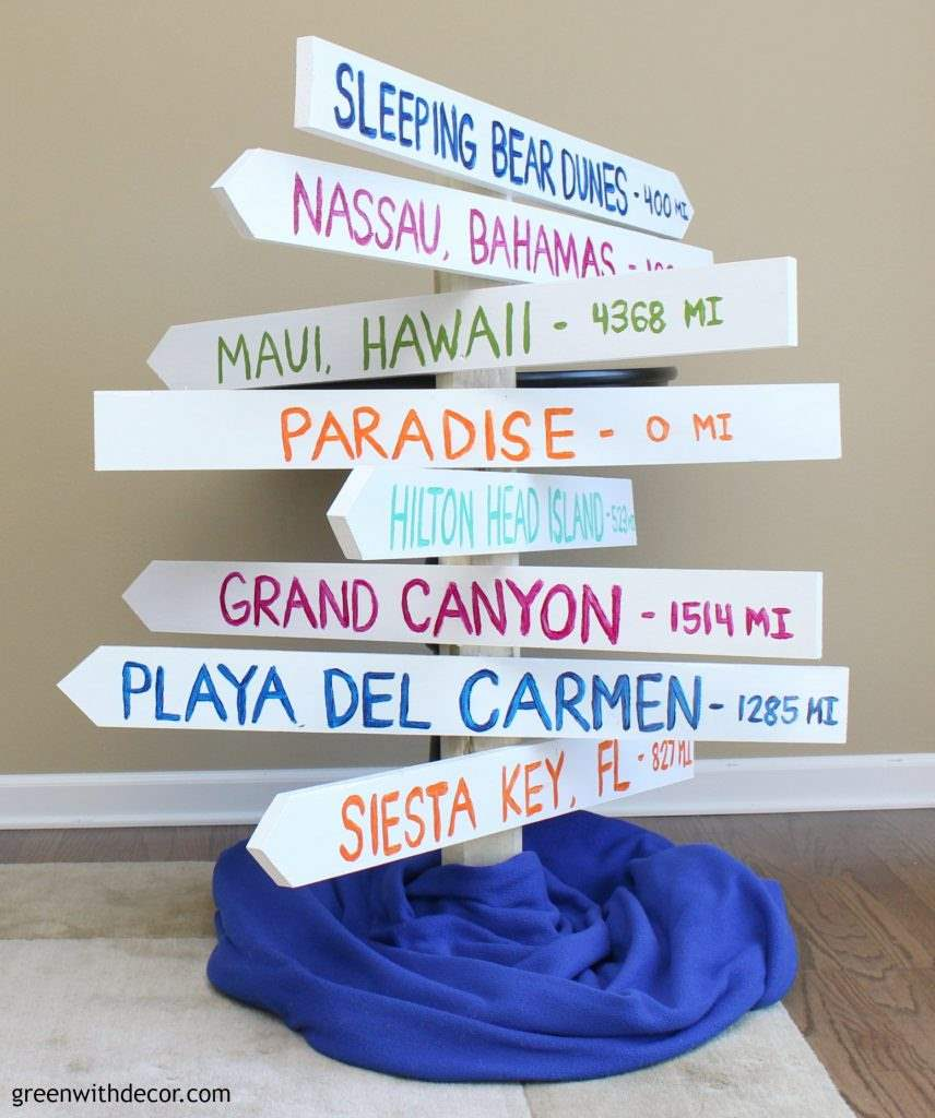 How to make a distance arrow sign so you can remember all of your fabulous vacations. A fun DIY project with a saw and some paint!