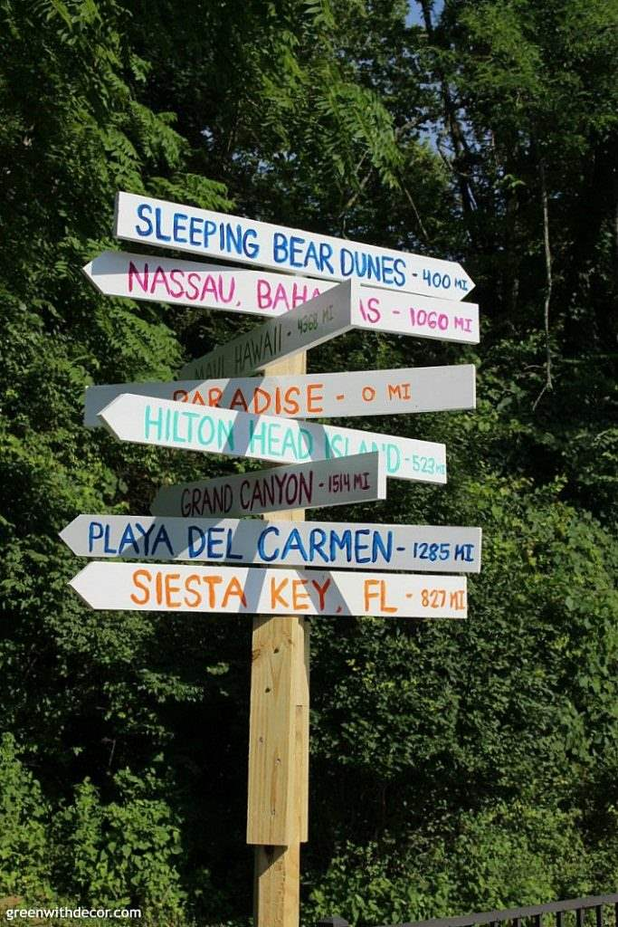 How to make a destination arrow sign so you can remember all of your fabulous vacations. A fun DIY project with a saw and some paint!
