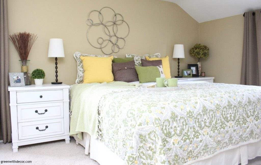 Gorgeous tan paint color - Sherwin Williams' Camelback. Love it in this blue, green and yellow coastal bedroom!