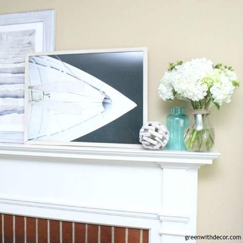What to use for a summer mantel | Love the beachy picture frames with the colored glass vases and rope sphere | summer decorating ideas for the mantel | summer decor | mantel decorating ideas