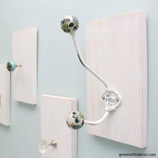 A DIY towel rack from old knobs and hooks + an easy gallery wall hanging trick
