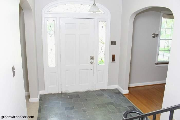 Gorgeous shade of gray: Agreeable Gray by Sherwin Williams. This foyer has so much old charm, the gray paint brightens it right up!