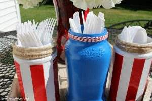 Make these easy Fourth of July DIY silverware jars from old jalapaeno and spaghetti sauce jars. What a great idea for corralling silverware a summer picnic!