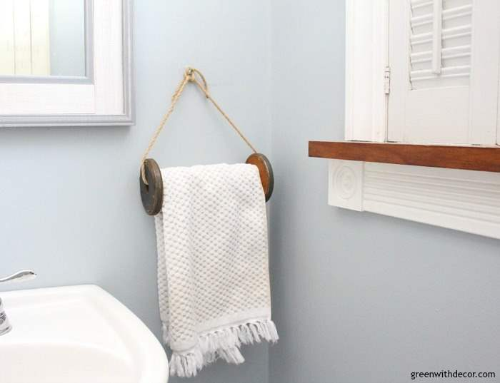 A DIY towel rack from an old wooden spool. Great DIY project for the bathroom and it takes just 5 minutes! Perfect for a coastal or farmhouse bathroom.
