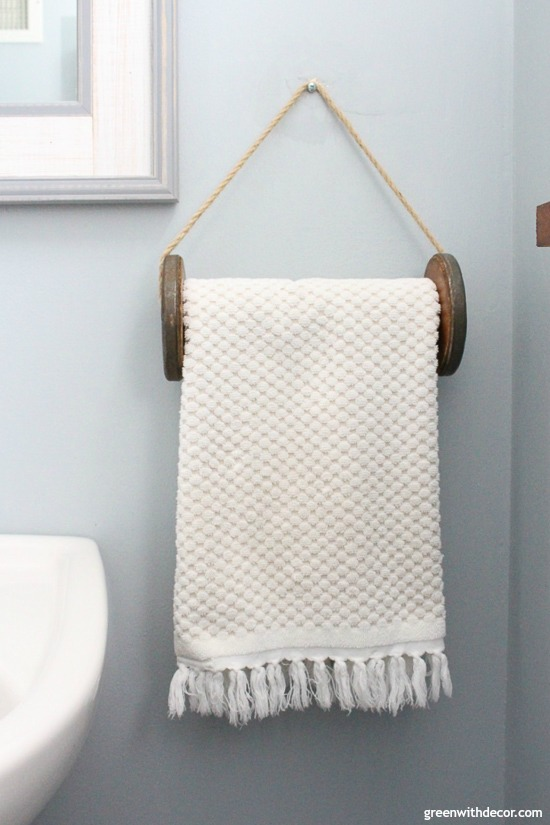 A list of the 10 best pieces to buy at the thrift store - spool turned DIY towel rack
