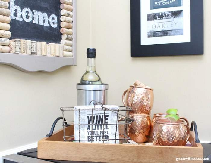 A pretty thrift store tray with copper Moscow Mule mugs, pretty wine napkins and a wine cooler.