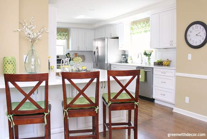Such a pretty tan paint color - the perfect warm neutral! Sherwin Williams' Camelback looks great in this all white kitchen!