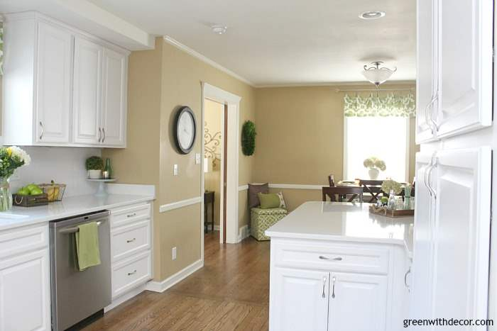 Pretty Camelback tan walls - paint color is by Sherwin Williams. It looks great in this white kitchen!