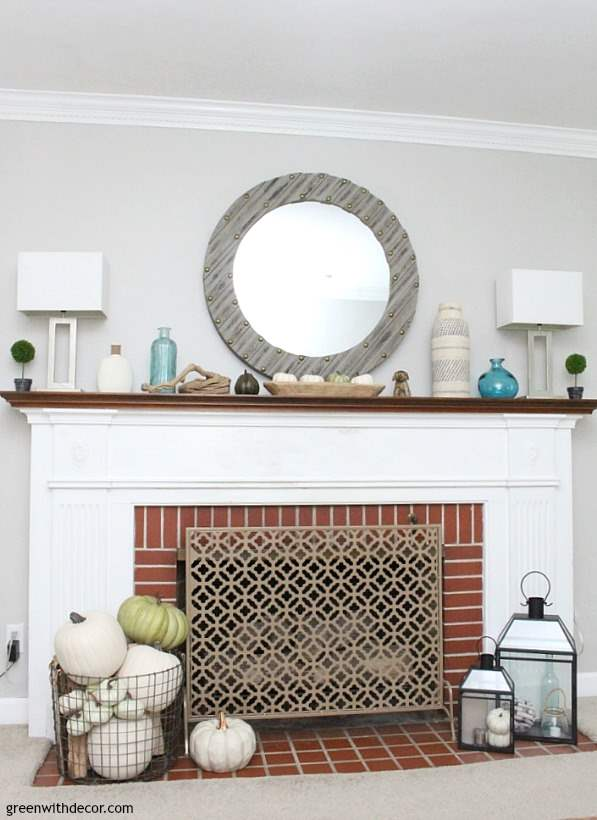 A fall coastal mantel when you don't have any time to decorate. Love the green and white pumpkins everywhere paired with the beachy aqua glass bottles!