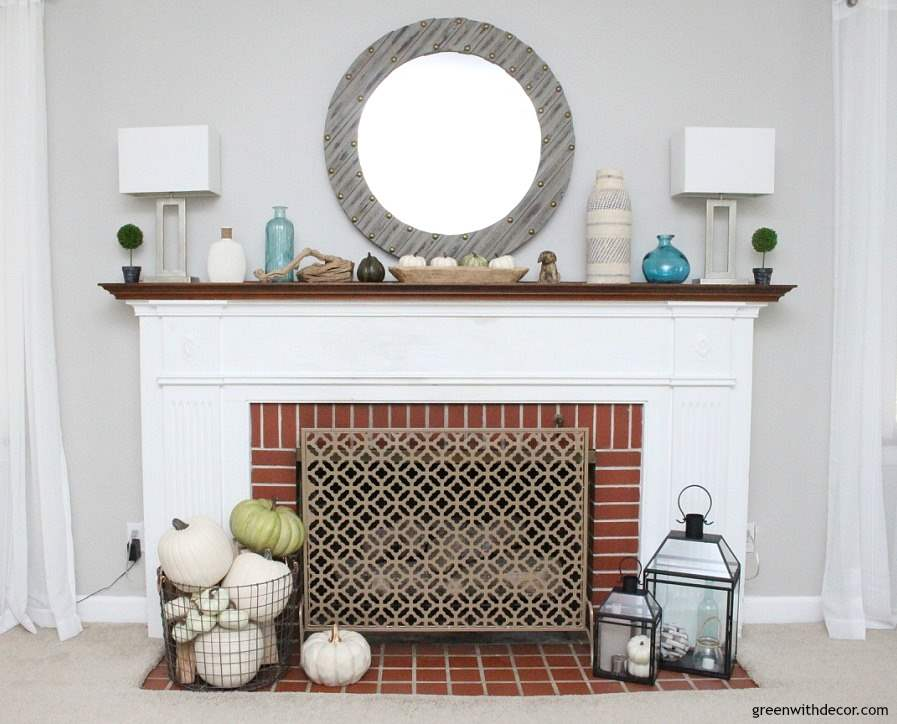 A fall coastal mantel when you don't have any time to decorate. Love the green and white pumpkins paired with the beachy glass bottles!