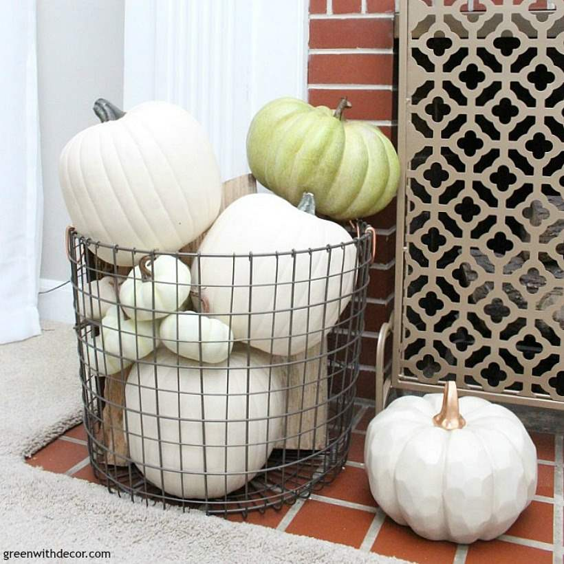 A fall coastal mantel when you don't have any time to decorate. Love the green and white pumpkins everywhere paired with the beachy glass bottles!