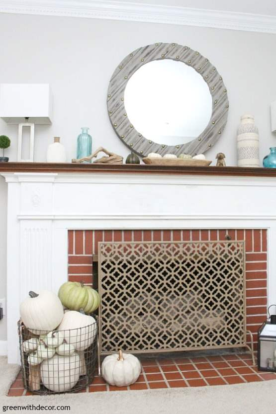 A fall coastal mantel when you don't have any time to decorate. Love the green and white pumpkins everywhere paired with the beachy aqua and white glass bottles