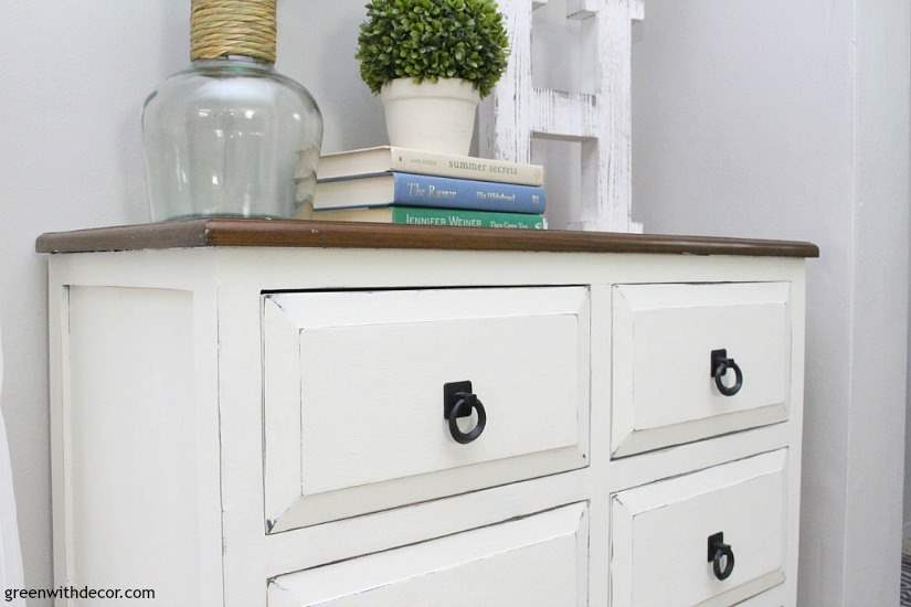 Learn to give a dresser a chippy farmhouse look. Transform any dark dresser into a white chippy farmhouse piece with this easy clay paint tutorial. Give a dresser a makeover for a farmhouse look.