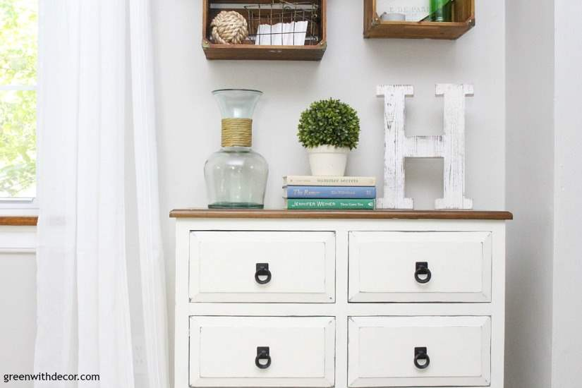 Learn to give a dresser a chippy farmhouse look. Transform any dark dresser into a white chippy farmhouse piece with this easy clay paint tutorial. A great dresser makeover if you want a distressed chippy white farmhouse look.
