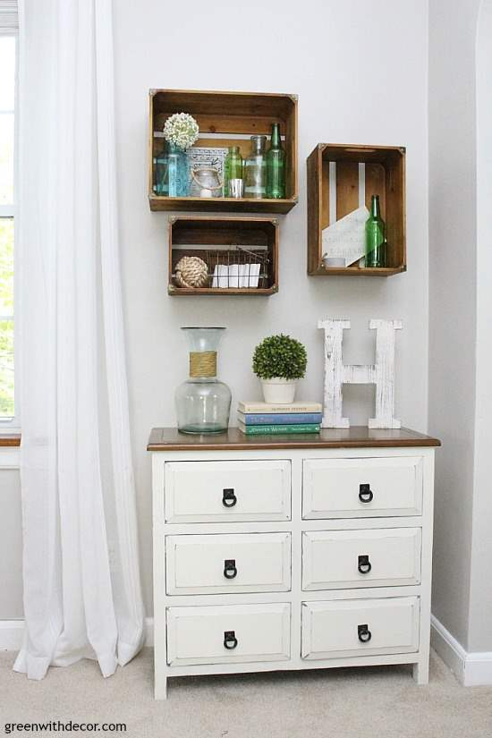 A list of the 10 best pieces to buy at the thrift store - crates used as wall shelves