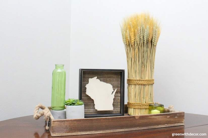 Easy fall decorating ideas for the mudroom, living room, mantel and other areas of the house. Throw some pumpkins and fall colors around and call it a day! Love this rustic coastal tray with the wheatgrass and wood state sign.