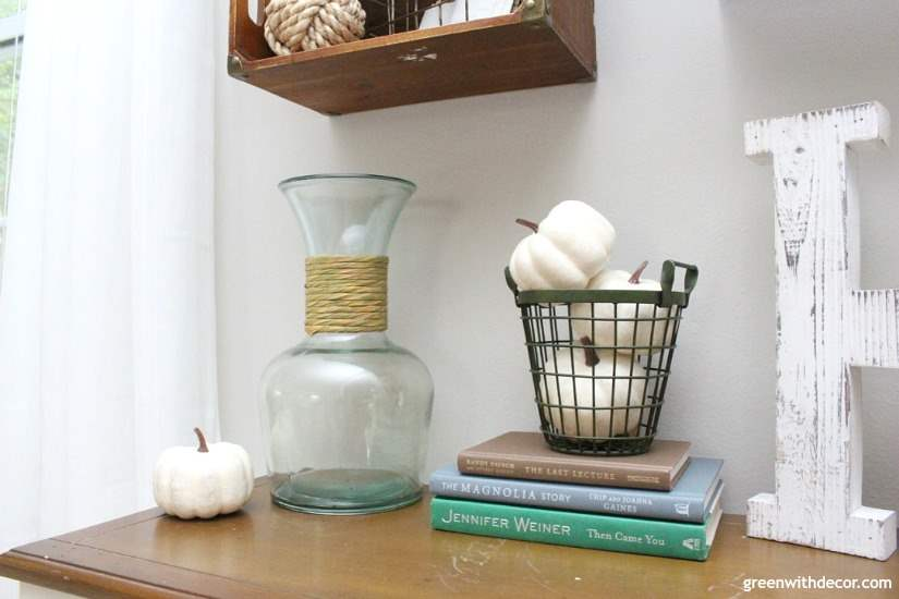 Easy fall decorating ideas for the mudroom, living room, mantel and other areas of the house. Throw some pumpkins and fall colors around and call it a day! Love the pumpkins tossed in this green farmhouse basket!