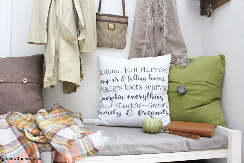 Easy fall decorating ideas for the mudroom, living room, mantel and other areas of the house. Throw some pumpkins and fall colors around and call it a day! This farmhouse fall pillow cover is perfect for a rustic look in this mudroom.