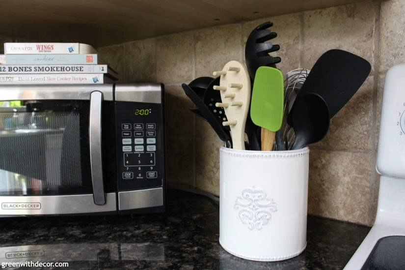 7 ways to update your kitchen when you can't renovate whether you're renting or don't have the budget for a kitchen renovation right now. The white utensil holder brightens up the dark granite, and love the green spatula!