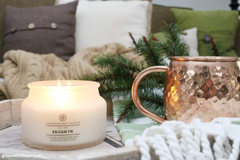 Delicious smelling Christmas candle in neutral colors. This is the perfect Christmas shot, with the rustic coastal look - Moscow Mule glass, pretty candle and neutral/green kitchen towel with tassels!