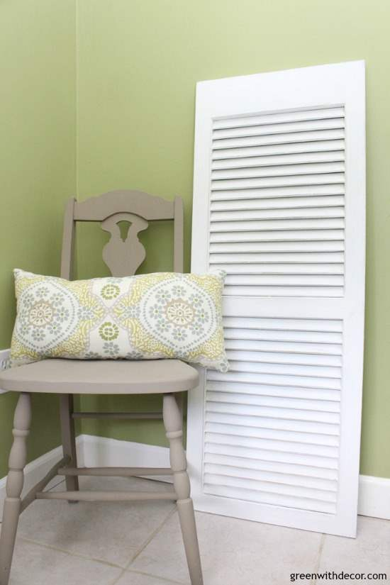DIY wall decor: A painted and distressed white shutter near a green wall