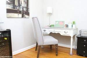 They turned this red wall into a cute home office! How to set up a home office you're comfortable in, even when you don't have an extra room. Plus a good trick for making a desk a few inches taller!