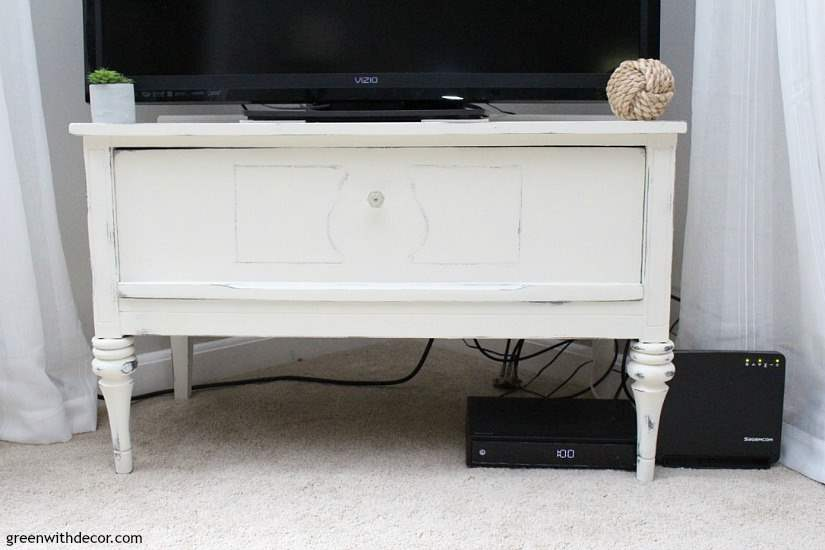 How to give a beat up piece a furniture makeover. A great tutorial for how to use clay paint, how to use wood putty and how to use wax to seal a piece. Such a fun TV stand!