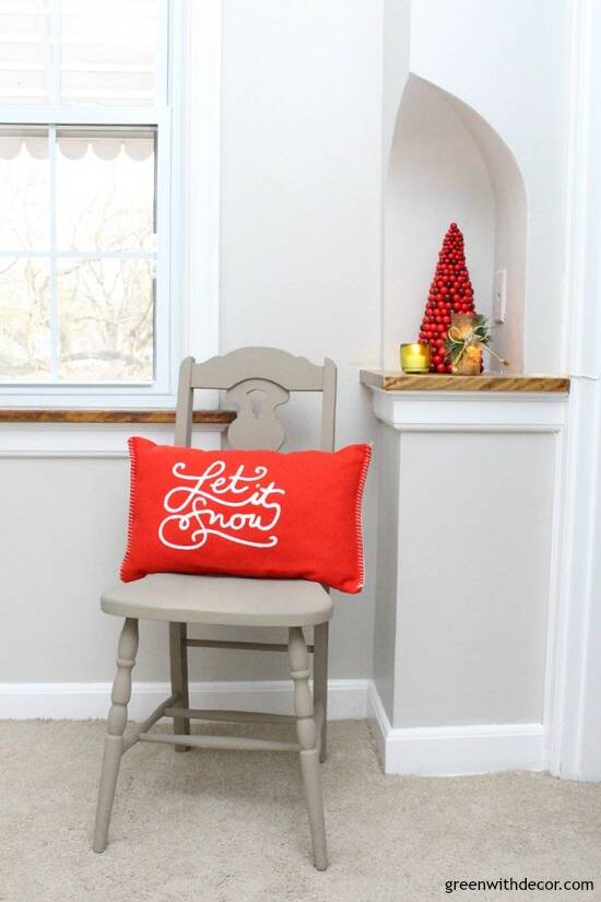 Christmas decorating ideas for a hallway. Love that mini red Christmas tree and the clay painted chair!