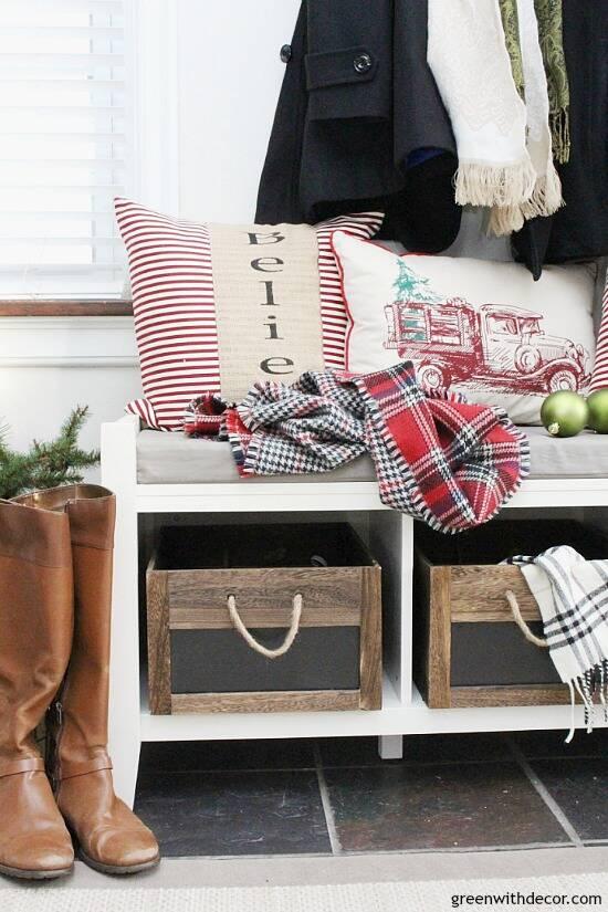 Christmas decorating ideas for the foyer. Love those rustic wood crates with the pretty Christmas throw pillows and scarves! Such a pretty neutral Christmas foyer!