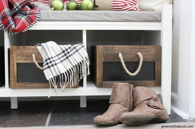 Christmas decorating ideas for the foyer. Love those gorgeous rustic wood rope crates with the pretty Christmas throw pillows and scarves!