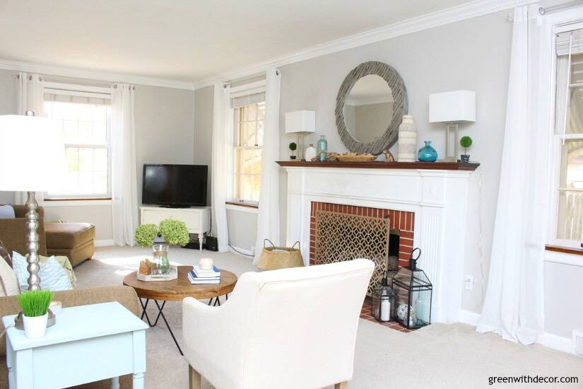 The costal rustic living room reveal - gorgeous beachy coastal living room with budget-friendly decorating and DIY projects. Love that coastal gallery wall and all the furniture makeovers. Gorgeous mirror above the fireplace!