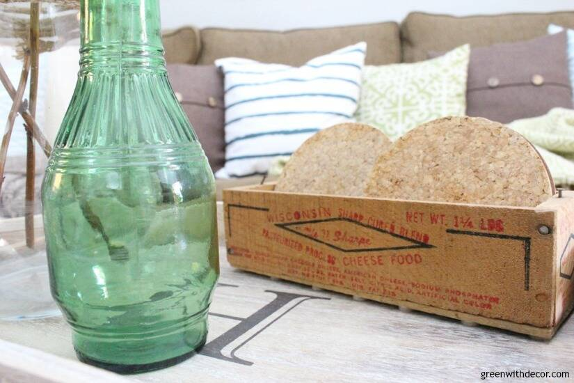 The costal rustic living room reveal - gorgeous beachy coastal living room with budget-friendly decorating and DIY projects. Love that little wooden crate for coasters!